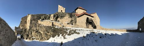Old fortress Rupea in winter - Romania. Historical fortress of Rupea, German Reps; Hungarian: KÅ'halom, `mound of rocks`; Latin Ripa is a town in BraÈ™ov stock images