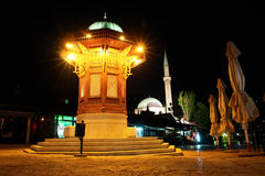 Historical fount in Sarajevo - Night scene. Historical fountain in Bascarsija in Sarajevo, the capital city of Bosnia and Herzegovina - Night scene Stock Image