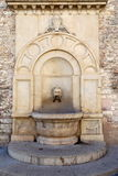 Historical fountain Consuls Palace in Gubbio Royalty Free Stock Images