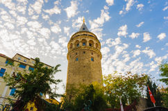 Historical Galata Tower with cloudy blue sky. Stock Photo