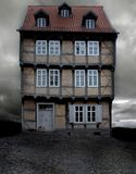 Historical German house on a gloomy evening. Historical German house with X-mas lights on a gloomy evening Stock Photo