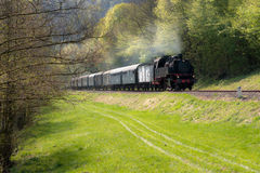 Historical German steam train. In spring mountains of Frankische Schweiz Stock Photos
