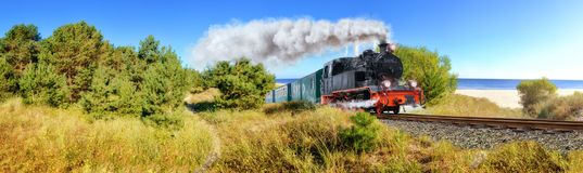 Historical German steam train in spring, Rugen, Germany. Panoramic image stock photography