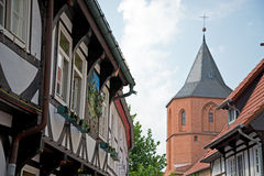 Historical half-timbered house and church Stock Photo