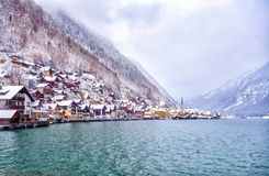 Winter in the Hallstatt town on a lake in Alps mountains, Austri. Historical Hallstatt town on an alpine lake in Alps mountains, Austria, snow covered in winter Stock Images