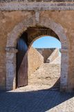 Gate in fortification, El Jadida, Morocco. Historical heritage, portuguese fortress on the coast of Atlantic ocean. Door in the fortification wall. Bright blue Stock Photos