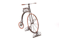 Historical high-wheel bicycle on a white background. Historical high-wheel children's bicycle on a white background Royalty Free Stock Photo