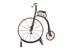 Historical high-wheel bicycle on a white background. Historical high-wheel children's bicycle on a white background Royalty Free Stock Photos