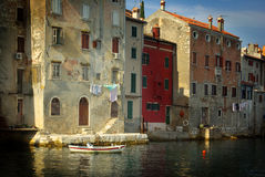 Historical houses built in sea. Historical houses on the coastline of Croatia, built at the picturesque town of Rovinj Royalty Free Stock Photo