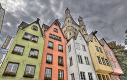 Historical houses in Cologne, Germany. Colorful German historical houses and the tower of Great St. Martin Church in the Altstadt of Cologne, Germany Royalty Free Stock Image