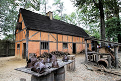 Historical Jamestown Virginia Building and Artifacts. This is a historical building in the Jamestown Settlement in Virginia USA. The table has helmets from 1600s Stock Photos