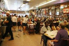Historical Katz's Delicatessen full of tourists and locals. NEW YORK - SEPTEMBER 20, 2015: Historical Katz's Delicatessen full of tourists and locals. Since its stock image
