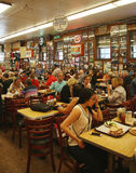 Historical Katz's Delicatessen full of tourists and locals Stock Photography