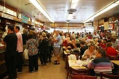 Historical Katz's Delicatessen full of tourists and locals. NEW YORK - SEPTEMBER 20, 2015: Historical Katz's Delicatessen full of tourists and locals. Since its royalty free stock image