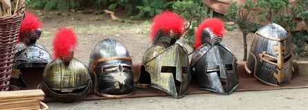Historical Knight Helmets. Several types of artificial historical knight helmets including gothic helmets and roman helmets which were used on the battle field Royalty Free Stock Photography