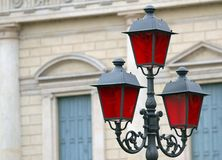 Historical lantern with Christmas red glass for street furniture Royalty Free Stock Photography