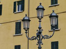 Historical lanterns on a square in Brescia Stock Photo