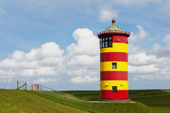 Historical Lighthouse at the North Sea in Germany`s Pilsum. Stock Image