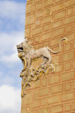 Historical lion relief on wall and sky Royalty Free Stock Image