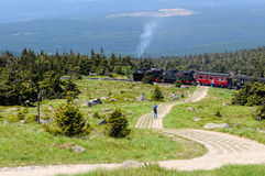Historical locomotive is going up high to Brocken Peak Stock Photos