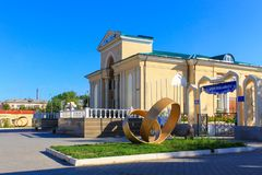 Main Entrance to the large Cinema Theater, called Wostok with Monuments. Located in Temirtau, Kazakhstan royalty free stock photography