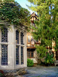 Historical Manor in the botanical garden NJ. English tudor style. manor house surrounded by trees royalty free stock photo