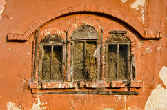 Historical manor building windows with straw Stock Photos
