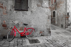 Historical Mediterranean town street with red bike Stock Image