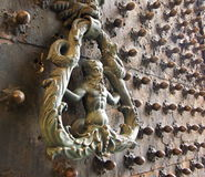 Historical metal door handle with a man figure Royalty Free Stock Photography