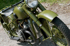 Historical military green motorbike Stock Photo