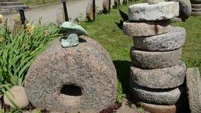 Historical millstones collection in  museum garden stock footage
