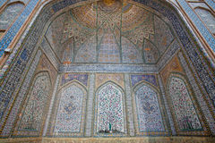 Historical mosque with tiled walls and Persian patterns Stock Photos