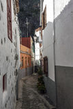 Historical narrow alley. The narrow alley of the seaside village in Gomera Island Royalty Free Stock Image