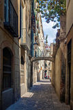 Historical narrow street in barcelona. Narrow clean street with stone pavement Stock Photos