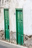 Historical old door - the color is peeling off Royalty Free Stock Photography