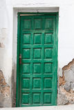 Historical old door - the color is peeling off Stock Photography