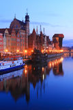 Historical Old Town of Gdansk at Motlawa River, Poland. Famous Old Town of Gdansk at Motlawa River with medieval crane building at the dusk, Poland Stock Images