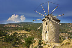 Historical old windmill with a dramatic sky background Royalty Free Stock Image