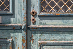 Historical old wooden door - the color is peeling off Stock Photos