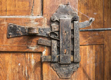 Historical padlock on the wooden door Stock Images