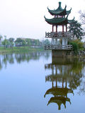 Historical pagoda in Shanghai. Surrounded by a lake. Location in China Royalty Free Stock Photography