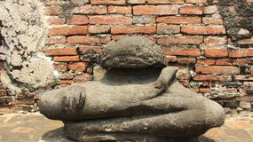 Historical Park With Old Stone Buddha Statue And Brick Walls. Ancient stone Buddha with brick walls.  Ruins And Historical Park in Ayutthaya Thailand stock photos