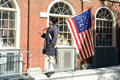 Historical Patriot Reenactor, Boston, USA. Historical Patriot Reenactor holds historical US flag in downtown Boston, Massachusetts, USA Stock Photography