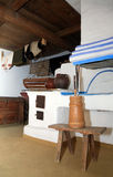 Historical peasant dwelling interior with stove Royalty Free Stock Photo