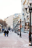 Historical pedestrian Arbat street in Moscow. MOSCOW, RUSSIA - JANUARY 19, 2014: people on Arbat street in Moscow. Arbat has existed since the 15th century, it Stock Image