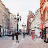 Historical pedestrian Arbat street in Moscow. MOSCOW, RUSSIA - JANUARY 19, 2014: people, souvenir shops on Arbat street in Moscow. Arbat has existed since 15th Royalty Free Stock Image
