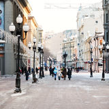 Historical pedestrian Arbat street in Moscow. MOSCOW, RUSSIA - JANUARY 19, 2014: people walk on Arbat street in Moscow. Arbat has existed since the 15th century Royalty Free Stock Photography