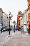 Historical pedestrian Arbat street in Moscow. MOSCOW, RUSSIA - JANUARY 19, 2014: tourists , souvenir shops on Arbat street in Moscow. Arbat has existed since Royalty Free Stock Images