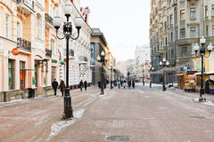 Historical pedestrian Arbat street in Moscow. MOSCOW, RUSSIA - JANUARY 19, 2014: tourists walk on Arbat street in Moscow. Arbat has existed since the 15th Royalty Free Stock Photo