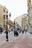 Historical pedestrian Arbat street in Moscow. MOSCOW, RUSSIA - JANUARY 19, 2014: tourists walk on Arbat street in Moscow. Arbat has existed since the 15th Royalty Free Stock Photography